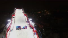 Ski jump for Freestyle World Cup at winter evening. Stock Footage
