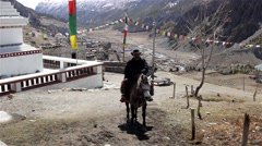 Man riding a horse in Nepal near pagoda Stock Footage