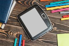 Tablet and School Supplies on Wooden Background Stock Photos