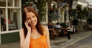 4k, young woman talking on her cellphone in a city. Stock Footage