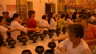 Thailand Buddhist Temple People Putting in Coins Stock Footage