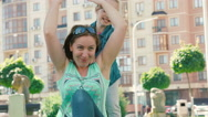 Mom and young daughter having fun in the park. Stock Footage