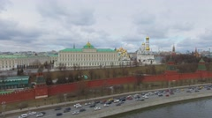 Traffic on Moskva river quay near Kremlin complex with Government Palace Stock Footage