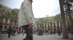 Royal Plaza in Barcelona, tourists posing near fountain in city square, Spain Stock Footage