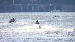 A man riding a jet ski on the river in a big city, slow motion Stock Footage