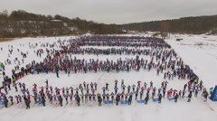 Rows of skiers wait on start place before race Lyzhnia Rosii Stock Footage
