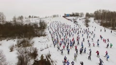 Skiers move up by hill in skate skiing style during race Lyzhnia Rosii Stock Footage