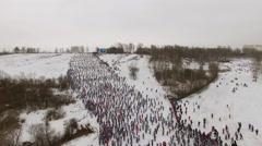 Large crowd of skiers move up by hill during race Lyzhnia Rosii Stock Footage