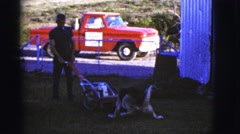 1968: man doing grounds work on his home or job with help from his canine friend Stock Footage