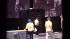 1968: visitors at the center reading the plague for historical information Stock Footage