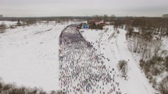 Snow-clad suburb with many people during ski race Lyzhnia Rosii Stock Footage