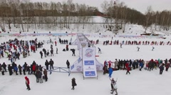 Finish of many sportsmen during race Lyzhnia Rosii at winter day Stock Footage