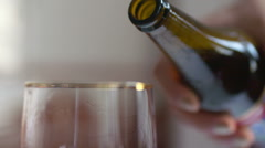 Beer is pouring into the glass in native slow motion scene Stock Footage
