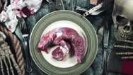 4k Horror and Bloody Composition of a Plate with Raw Meat for Dinner Stock Footage
