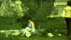 1973: two women outside with a beautiful structure visible in the distance Stock Footage