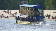 Old-fashioned tourist boat floats the river, slow motion Stock Footage
