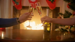 Hands of couple in love clinking glasses with champagne at Christmas eve. Man Stock Footage