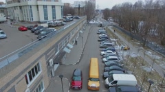 Yellow limousine ride among cars near house. Aerial view Stock Footage