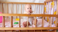 Beautiful baby girl sitting in bed Stock Footage