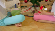 Closeup of two cute sister opening Christmas gifts at morning Stock Footage