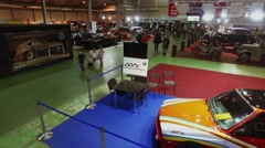 People walk among antique cars during exhibition. Aerial view Stock Footage