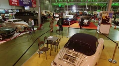 Visitors watch retro cars during exhibition. Aerial view Stock Footage