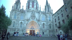 Majestic Barcelona Cathedral at dusk, tourists viewing Gothic architecture Stock Footage