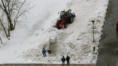 Workers and tractor remove snow coast at early spring day. Timelapse Stock Footage
