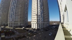 Cars and people near apartment complex during sunny day. Timelapse Stock Footage