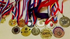 Many different medals on colorful ribbons. Timelapse Stock Footage
