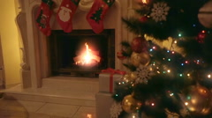 Fire inflames in fireplace at living room decorated for Christmas Stock Footage