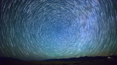 Astro Time Lapse of Star Trails over Sand Dunes in Death Valley -Tilt Up- Stock Footage