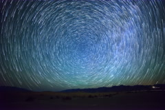 6K Astro Time Lapse of Star Trails over Sand Dunes in Death Valley  Stock Footage