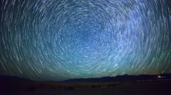 Astro Time Lapse of Star Trails over Sand Dunes in Death Valley -Tilt Down- Stock Footage