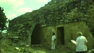 1973: people are seen in a tourist area and are observing a building MEXICO Stock Footage