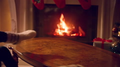 Closeup of male and female feet in woolen socks warming at fireplace Stock Footage