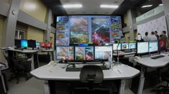 Data center infrastructure with many display and people in operations room Stock Footage