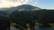 Aerial drone footage of lake and mountains against sky. Fast tracking shot of Stock Footage