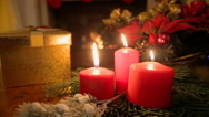 Closeup dolly shot of Christmas gifts and burning candle on table at living r Stock Footage
