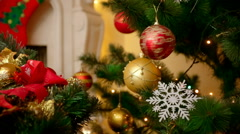 Closeup of beautiful Christmas tree decorated with colorful baubles and snowf Stock Footage