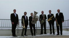 Group of musicians (with model releases) on roof of dwelling house Stock Footage