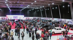 Many people walk by retro cars exhibition area. Aerial view. Stock Footage