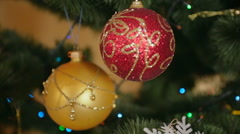 Steadicam shot around the Christmas tree with colorful baubles and lights Stock Footage