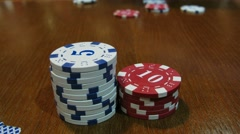 Poker game on wooden table with stacks of chips. Timelapse Stock Footage