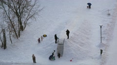 Parents with children get fun on snow coast at winter day. Stock Footage