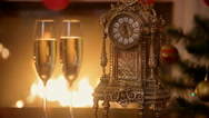 Closeup of two glasses of champagne next to old clock counting minutes to the Stock Footage
