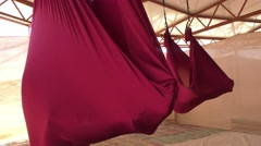 Yogi practice aerial anti gravity yoga on a hammock during Yoga Arava Stock Footage