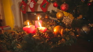 Dolly shot of Christmas wreath with burning red candles on table at living ro Stock Footage