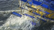 Aerial view of the old-fashioned tourist ship rotates decorative blades, slow mo Stock Footage