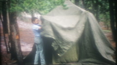 Weekend campers set up tents at the campground-3621 vintage film home movie Stock Footage